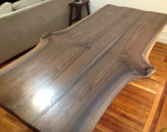 live edge walnut bookmatched slab dining table on golden steel base