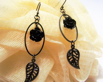 gun metal earrings with black resin flower, gun metal hoop and gun metal leaf