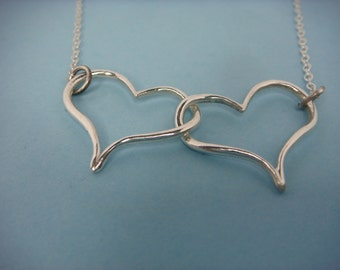 Double Heart pendant in fine silver with sterling silver trace chain.