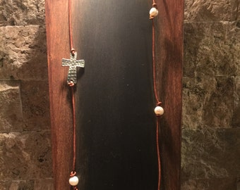 Brown leather necklace with freshwater pearls and a silver cross