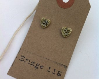 Ceramic heart stud earrings with olive green colour