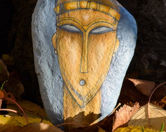 Hand painted stone with a figure from a Modigliani's drawing