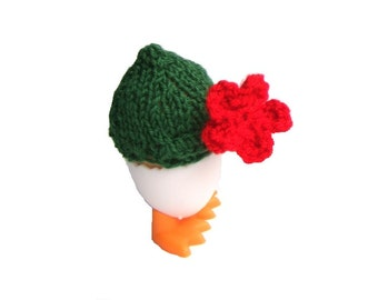 Egg Cozy Gentleman with red flower romantic table decoration for a birthday breakfast or wedding anniversary brunch