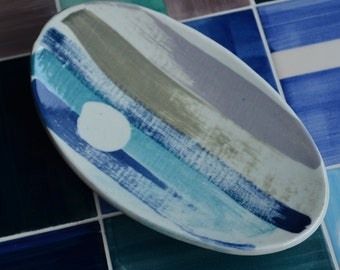 blue ceramic bowl with three legs