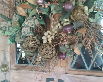 Autumnal Wreath with Grapes, Artichokes, Eggplant. Fall Berries, Grapevine Spheres, and Trimmed with Fabric Wired Ribbon in Jewel Green.