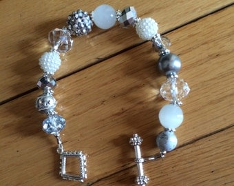 While and silver tone braclet.