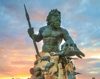 Neptune Statue on Virginia Beach boardwalk Sunrise clouds colorful blue pink red and orange sky