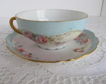O&EG Royal Austria China Tea Cup and Saucer