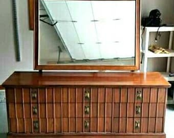 9 drawer mid century dresser made by Dixie furniture company