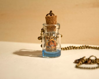 Handmade necklace with pendant-glass bottle containing resin and Wanted poster One Piece