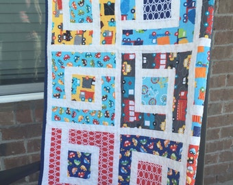 Toddler, baby quilt. Cars, trucks, bikes and bus theme