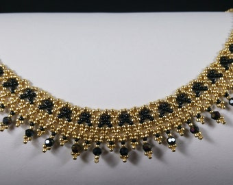 Art Deco beadwoven collarbone black and gold necklace.