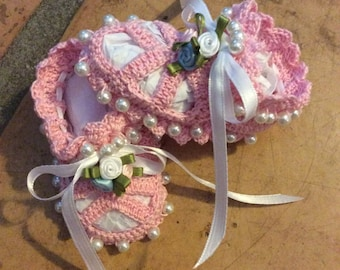 Baby booties with satin rosettes
