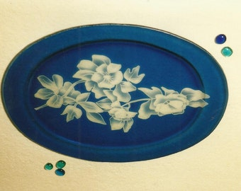 Oval glass tray blue plated with sand etched decoration.