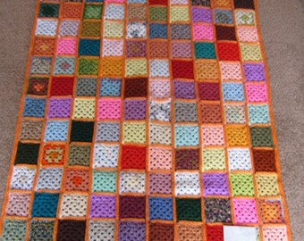Hand crocheted granny square afghan blanket
