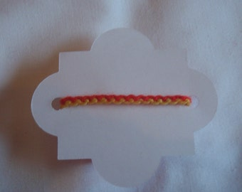 Zipper friendship bracelet. (Red and yellow.)