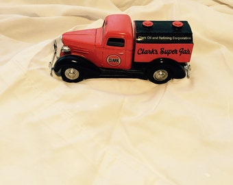 Locking coin bank toy truck