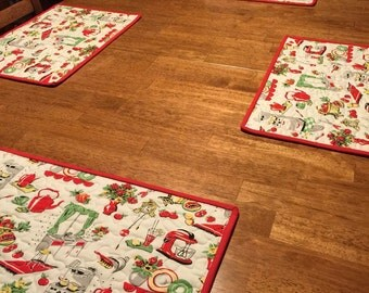 Set of 4 handmade quilted vintage style fabric placemats.
