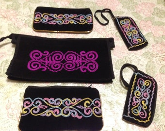 Embroidered cosmetic bag.