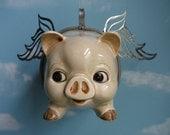 Vintage adorable tirelire jusqu'à récupéré dans un cochon volant
