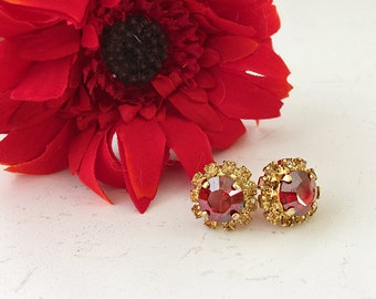 Swarovski stud earrings with red and gold crystals
