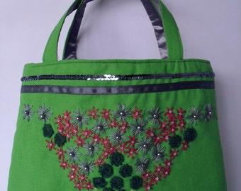 Emerald green daisies and roses bag