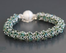 Bracelet round green and silver tubular weave oval beads with two holes Superduos Japanese seed beads clasp ball magnet