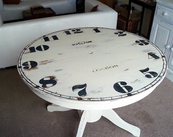 Clock face table seats 6 - 8 extending with extra hours