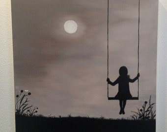 Girl on Swing Looking at Moon