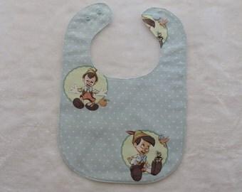 Pinocchio and polka dots  baby bib