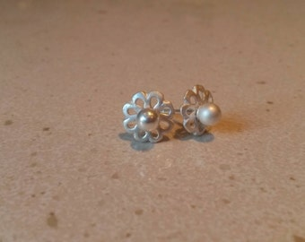 Small sterling silver flower studs.
