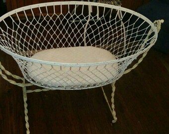 Antique rocking wrought iron infant bassinet