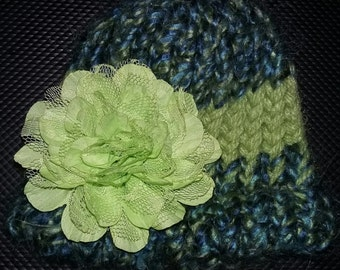 knitted premie hat in shades of green with green accent flower