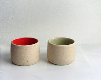 Pair of salt and pepper 'pinch pots' in orange/green