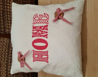 """HOME"" pillow in red"