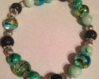 Green glass and lava bead Stretch Bracelet