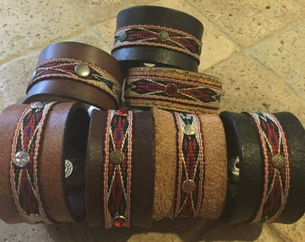 Leather cuff bracelet with southwestern band and rivets / rhinestones