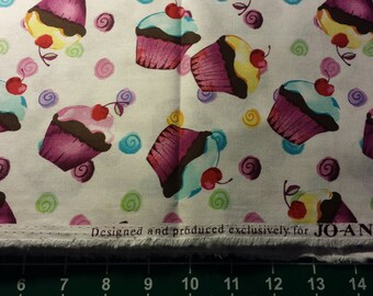 Tossed Cupcakes Cotton Fabric  by The Yard