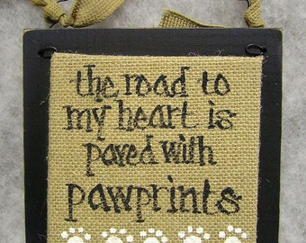 PAWPRINTS SIGN