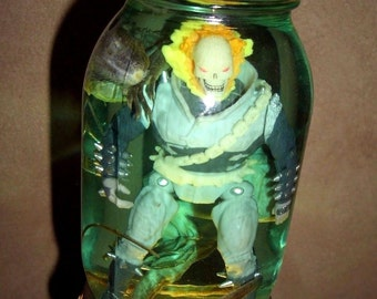 Ghost Rider Wrapped in a Wet Specimen Iguana.