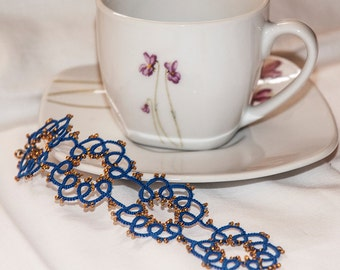 Bracelet made in electric blue with Golden beads cotton tatting