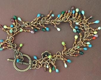 Enameled wire charm bracelet