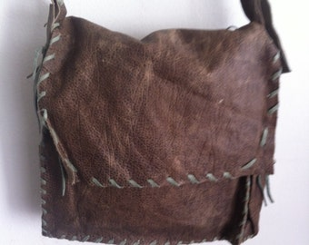 Brown blue big shoulder bag on a long strap, a bag made of genuine leather.