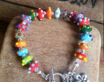 funky bright and fun glass lampwork bead bracelet with silver charms