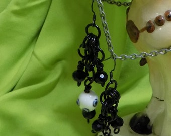 Chain mail earrings - black and white glass bead.