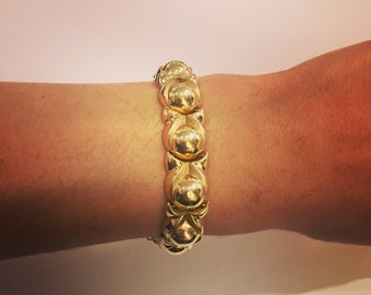 14K Gold bracelet with corcle design with clip.