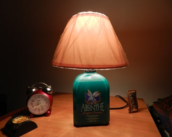 lamp with a bottle of Absinthe black