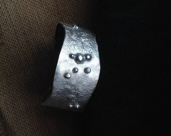 Reticulated sterling silver bangle