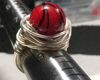 Red wire wrapped statement ring