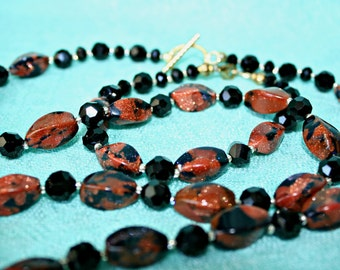 Glittering Amber and Black glass necklace with matching bracelet